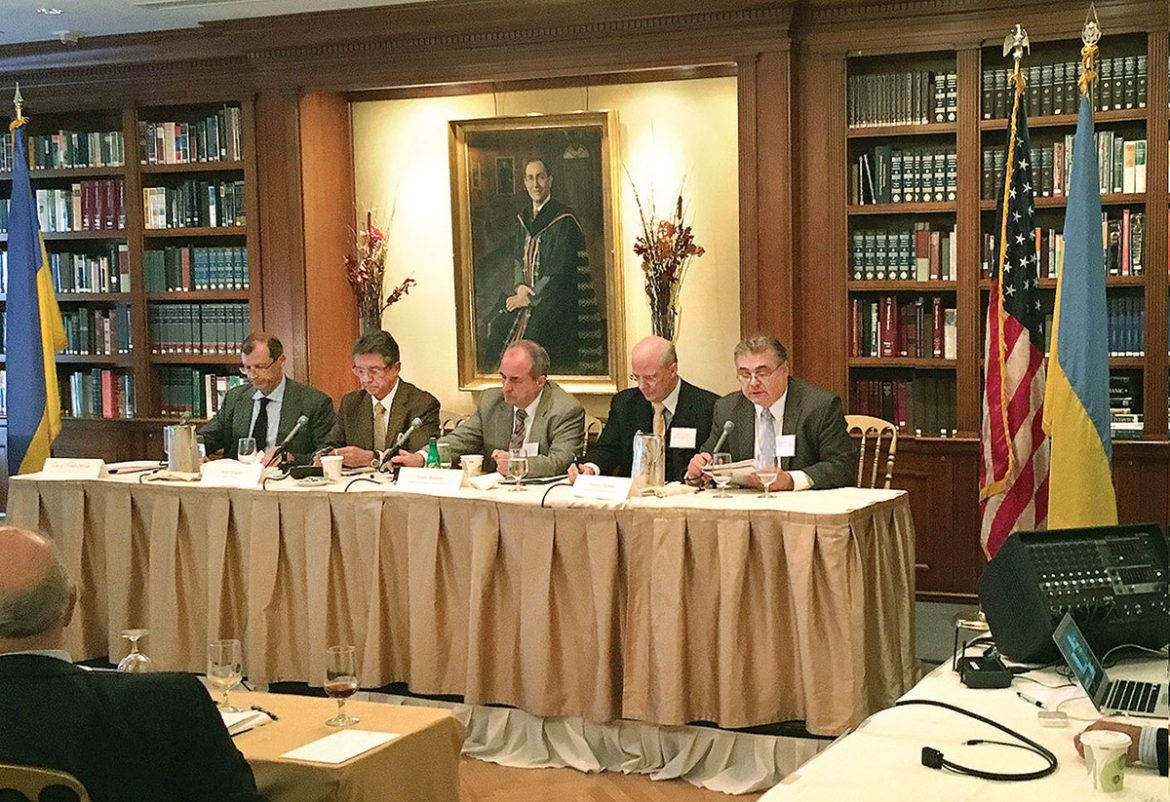 """One of the panels at the symposium held on September 17 at the Princeton Club of New York to mark """"The 25th Anniversary of the Modern Ukrainian State"""" was devoted to """"Contemplating Ukraine's Further Future."""" Mykola Hryckowian (right) reads the prepared remarks of Paul Goble of the Jamestown Foundation; seated (from left) are moderator Serhii Meshcheriak (formerly of the Council of Economic Security and Defense of Ukraine), Yuriy Sergeyev of Yale University, Janusz Bugajski of the Center for European Policy Analysis and Herman Pirchner of the American Foreign Policy Council."""