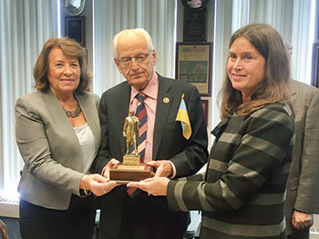 Rep. Bill Pascrell (D-N.J.) receives the Taras Shevchenko Freedom Award from the Ukrainian Congress Committee of America, represented by Executive Secretary Marie Duplak (left) and past president Tamara Olexy, at his office in Paterson, N.J., on November 2.
