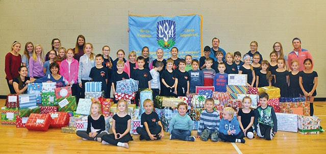 Children of the Ukrainian American Youth Association branch in Palatine, Ill., prepare to send gifts to children in Ukraine.