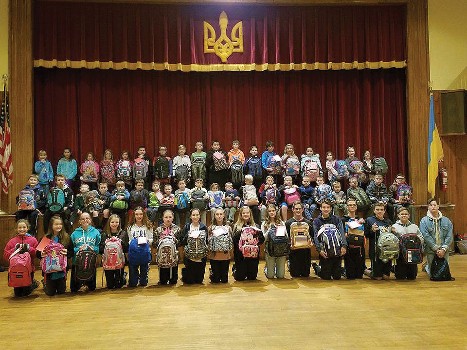 Children of the Ukrainian American Youth Association branch in Passaic, N.J., with their gifts for children in Ukraine.