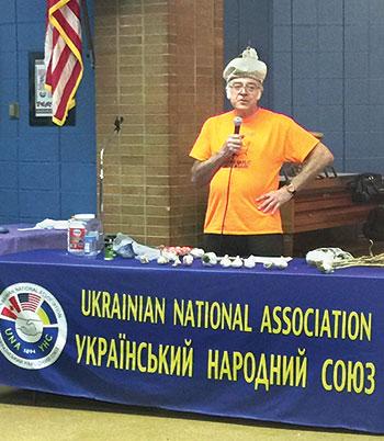 Roman Osadca promotes the many benefits of garlic to the parishioners of St. Nicholas Ukrainian Catholic Church.