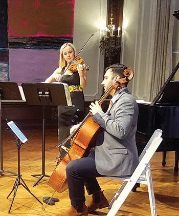 Performing during the concert are Solomiya Ivakhiv and Yves Dharamraj.