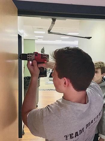 Matt Stefurak volunteering to help renovate the domivka.