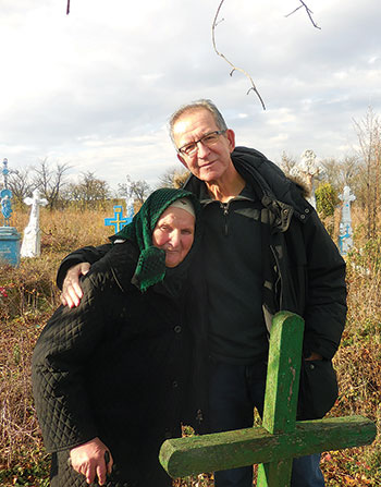 On November 11, 2016, Greg Stricharchuk embraces his maternal cousin, Olena Ziatyk, at the Ternopil region gravesite of his uncle after whom he was named – a discovery he made during the first of two visits over the past 10 months to meet his family for the first time.