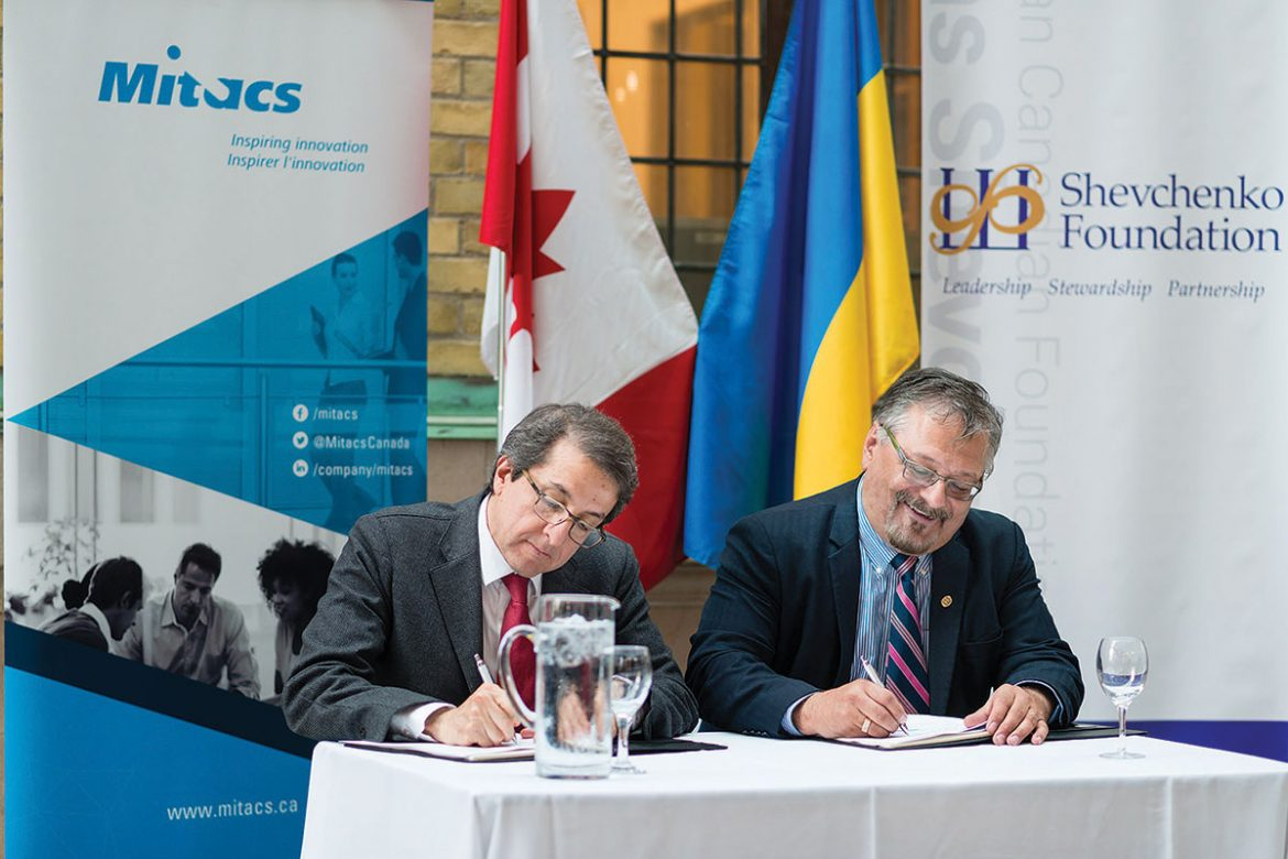 Alejandro Adem, Mitacs CEO and scientific director, and Andrew Hladyshevsky, president of the Shevchenko Foundation, signing a partnership agreement.