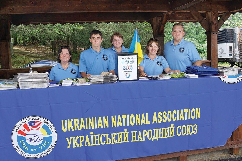 Employees and volunteers man the Ukrainian National Association gazebo.
