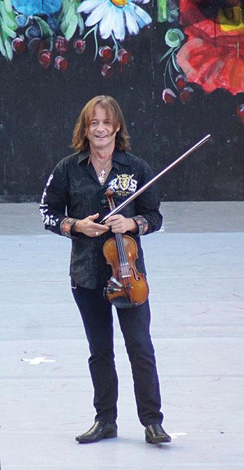 Violinist and co-MC of the stage program, Vasyl Popadiuk.