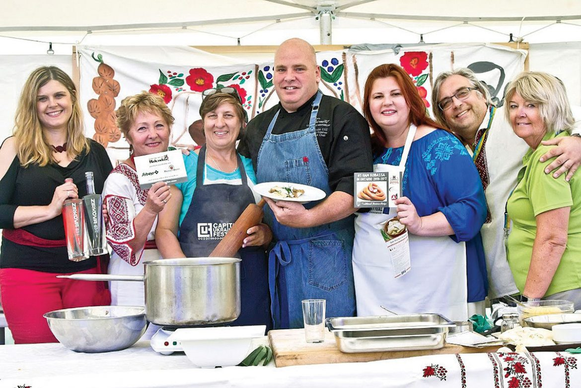 At Chef Tim's cooking demonstration (from left) are: Katherine Vellinga of Multiculture Bevco, Maria Lachowich of the Ukrainian Catholic Women's League of Canada, Mama Raisa, Chef Tim Wasylko of Fairmont Le Chateau Montebello, Jane Kolbe of Capital Ukrainian Festival, and Yuriy Diakunchak and Alison Conroy of the Ukrainian Credit Union.