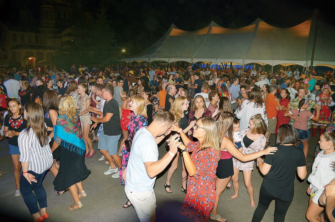 """The Saturday night crowd dances during the """"zabava."""""""