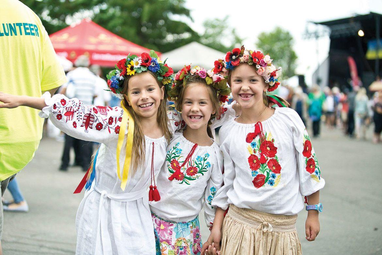 Three young girls enjoy the festival.