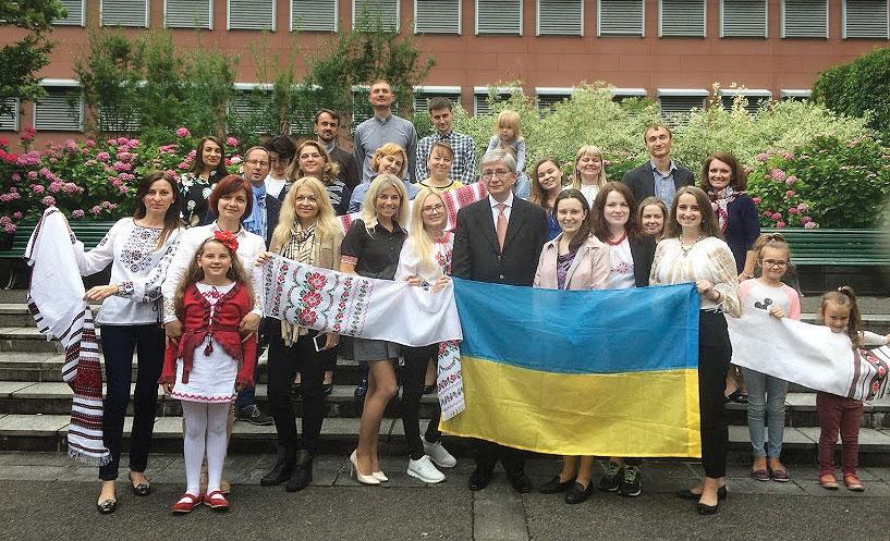 Ukrainian World Congress President Eugene Czolij with Ukrainian community members in Zurich.