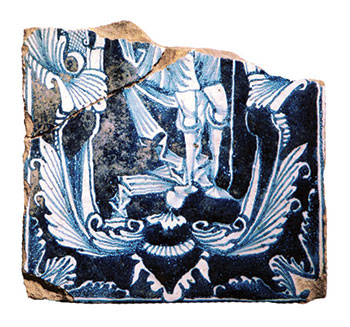 Half of a large glazed ceramic stove tile depicting a man and a floral ornament in the late baroque Dutch style, from Rozumovsky's palace-museum in Baturyn.