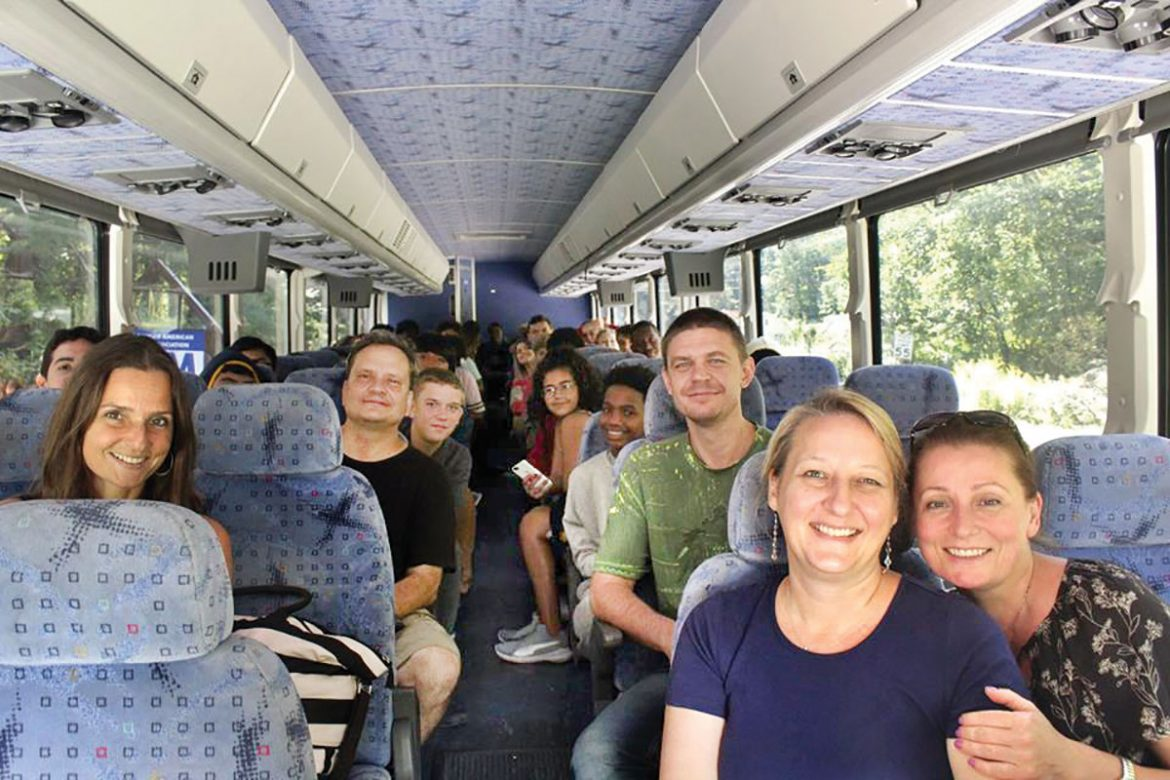 Students and faculty head upstate by bus.