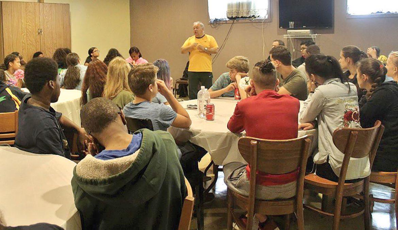 Father Ivan Kaszczak speaks with St. George Academy students.