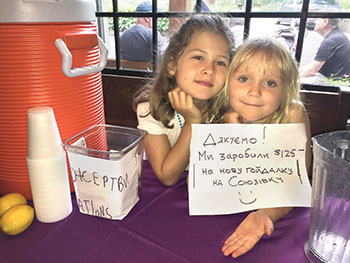 Kalyna Konrad and Zoryana Popadynec proudly wrap-up their lemonade stand at Soyuzivka with a thank-you to their patrons and a report on the fund-raiser's results.