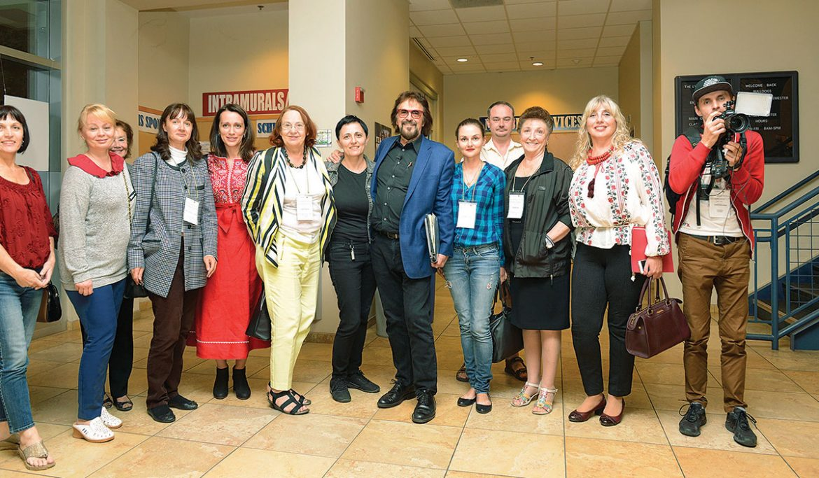 """Director/producer George Mendeluk with organizers and audience members after the screening of """"Bitter Harvest"""" at Fresno State."""