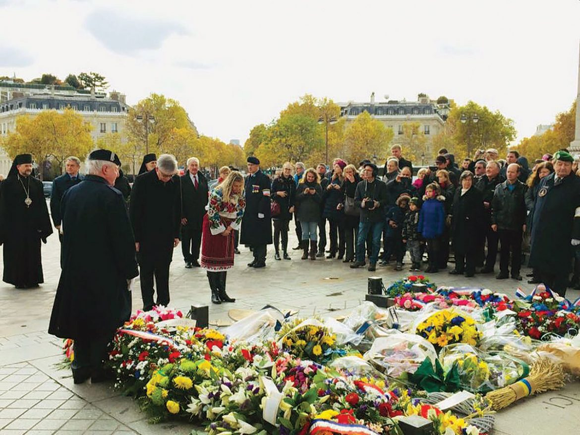 The wreath-laying ceremony for the victims of the Holodomor at the Tomb of the Unknown Soldier and Eternal Flame at the Arc de Triomphe in Paris.