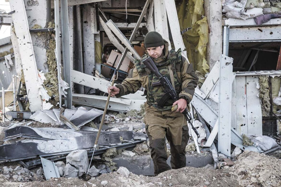 Ukrainian soldier searching for dead bodies at Donetsk airport in October 2015