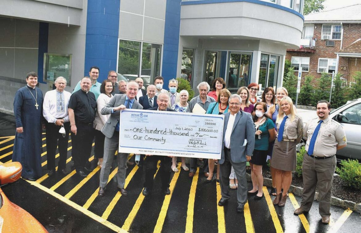 Nova UA Federal Credit Union presenting a one hundred thousand dollar check for grants to community organizations based in New Jersey